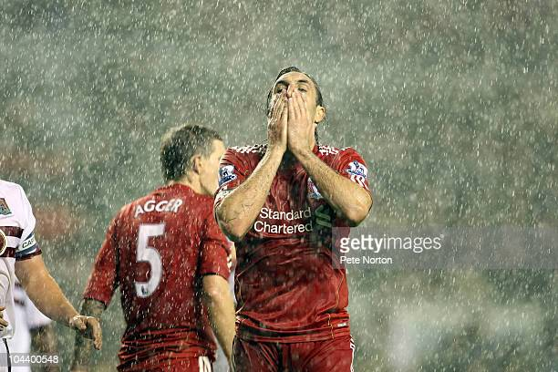 Sotiros Kyrgiakos of Liverpool holds his head after a shot had gone wide of the goal during the Carling Cup Third Round match between Liverpool and...