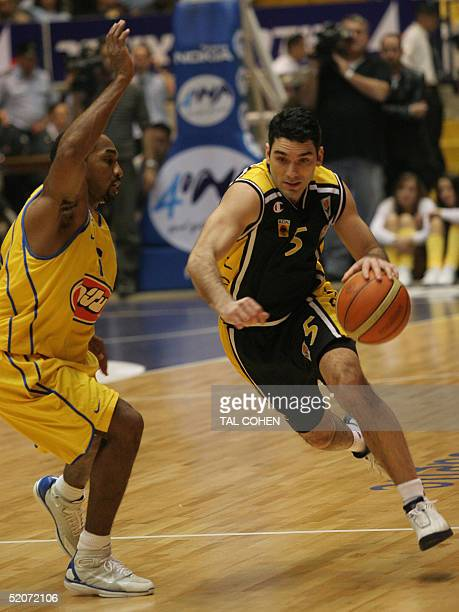 Sotitios Nikolaidis of AEK Athens attacks with the ball while Derrick Sharp of Maccabi Tel Aviv tries to stop him in the Euroleague Group B...