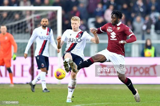 Soualiho Meite of Torino FC clashes with Jerdy Schouten of Bologna FC during the Serie A match between Torino FC and Bologna FC at Stadio Olimpico di...