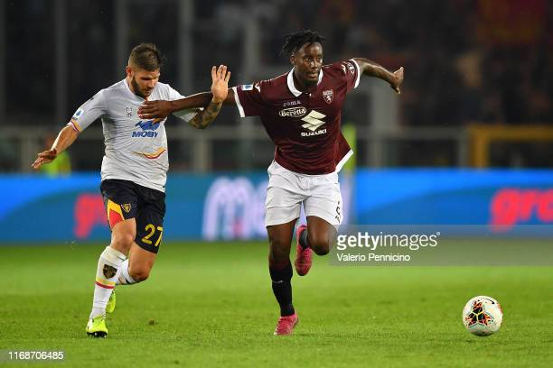 Soualiho Meite of Torino FC competes with Marco Calderoni of US Lecce during the Serie A match between Torino FC and US Lecce at Stadio Olimpico di...