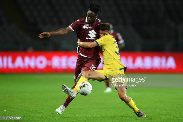Soualiho Meite of Torino FC competes with Matteo Pessina of Hellas Verona during the Serie A match between Torino FC and Hellas Verona at Stadio...