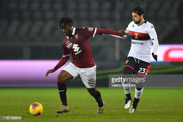 Soualiho Meite of Torino FC competes with Mattia Destro of Genoa CFC during the Coppa Italia match between Torino FC and Genoa CFC at Stadio Olimpico...