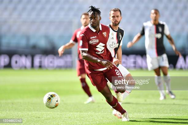 Soualiho Meite of Torino FC in action against Miralem Pjanic of Juventus during the Serie A match between Juventus and Torino FC at Allianz Stadium...