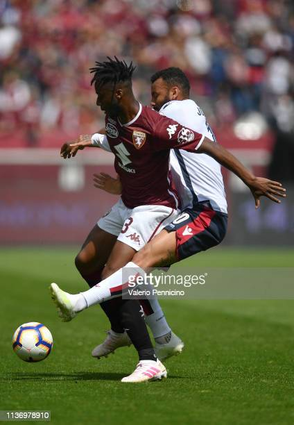 Soualiho Meite of Torino FC is challenged by Galvao Joao Pedro of Cagliari during the Serie A match between Torino FC and Cagliari at Stadio Olimpico...