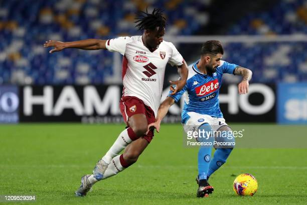 Soualiho Meite of Torino FC vies with Elseid Hysaj of SSC Napoli during the Serie A match between SSC Napoli and Torino FC at Stadio San Paolo on...