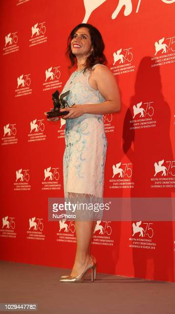 Soudade Kaadan poses with the Lion Of The Future 'Luigi De Laurentiis' Venice Award for a Debut Film for 'The Day I Lost My Shadow ' at the Winners...