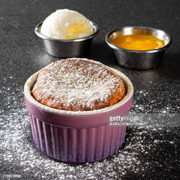 souffle cake and ice cream - soufflé stock-fotos und bilder