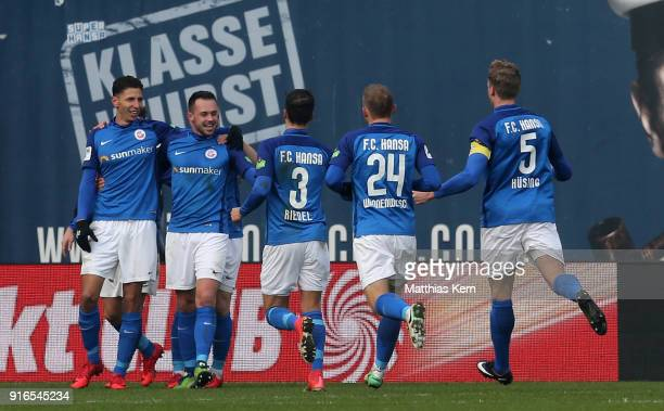 Soufian Benyamina of Rostock jubilates with team mates after scoring the first goal during the 3 Liga match between FC Hansa Rostock and FC...