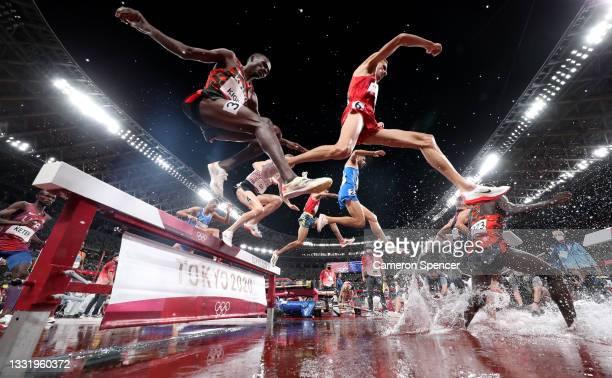 Soufiane El Bakkali of Team Morocco and Benjamin Kigen of Team Kenya compete in the mens 3000 metre Steeplechase final on day ten of the Tokyo 2020...