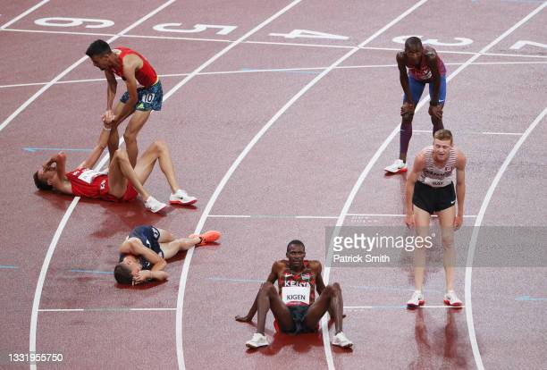 Soufiane El Bakkali of Team Morocco reacts with competitors after winning the gold medal in the men's 3000 metres steeplechase on day ten of the...