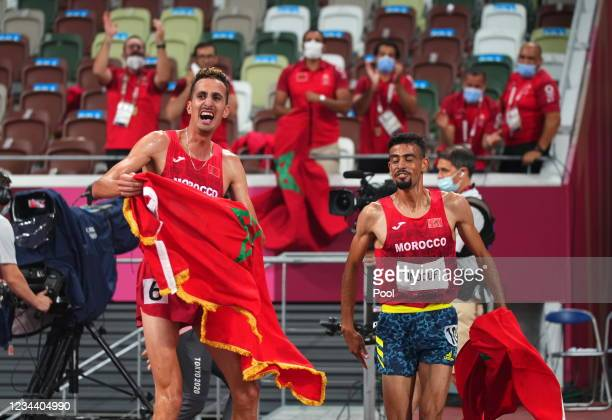 Soufiane Elbakkali of Morocco celebrates winning the gold medal with Mohamed Tindouft of Morocco after the Men's 3000m Steeplechase - Final on day...