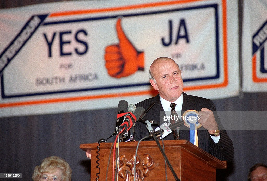 Souh African President Frederik Willem de Klerk clenches his fist as he addresses a packed hall of mostly students at the normal teachers' training college in Pretoria during his referendum rally, on March 13, 1992. In this referendum, white South Africans were asked to vote in the country's last whites-only referendum to determine whether or not they supported the negotiated reforms begun by State President F.W. de Klerk two years earlier.