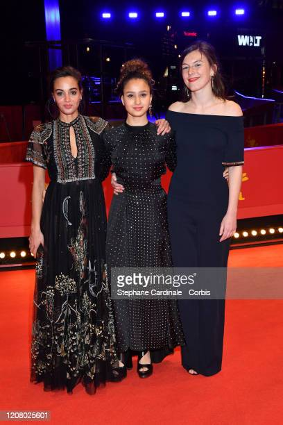 Souheila Yacoub wearing Dior Oulaya Amamra and Louise Chevillotte pose at the The Salt of Tears premiere during the 70th Berlinale International Film...