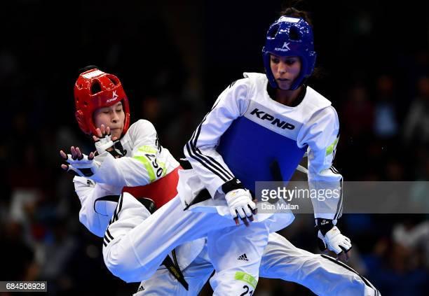 Soukayna El Aouni of Morocco competes against Umida Abdullaeva of Uzbekistan in the Womens Taekwondo 62kg Semi Final during day seven of Baku 2017...