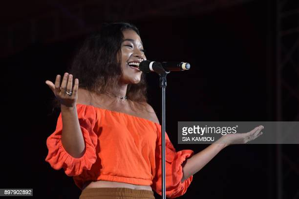 Soukeina the daughter of Ivorian reggae singer Alpha Blondy addresses the public prior to his father's concert at the Felix Houphouet Boigny...
