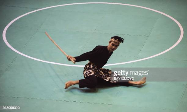 Souksavanh Chanthilath of Laos performs during men's single final of Asian Games 2018 test event in Jakarta on February 14 2018 / AFP PHOTO / BAY...