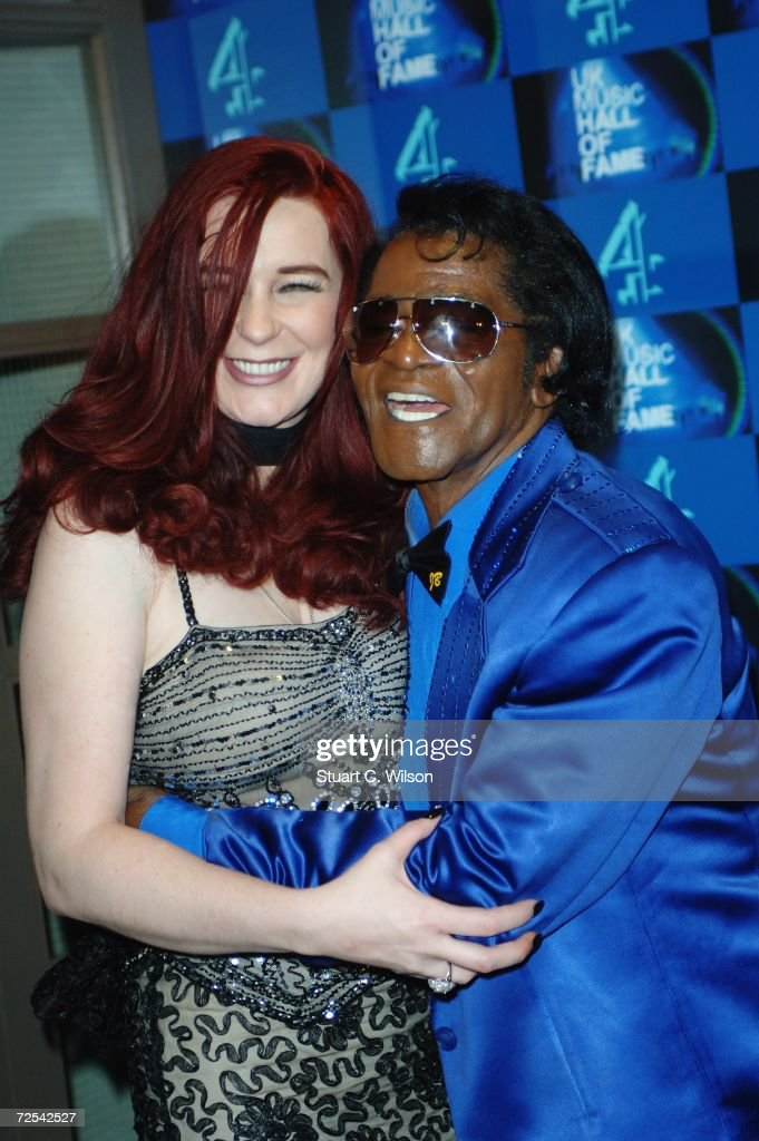 Soul music legend James Brown poses with Tomi Rae Hynie in the Awards Room at the UK Music Hall Of Fame 2006, at Alexandra Palace on November 14, 2006 in London, England.