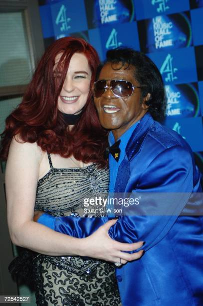 Soul music legend James Brown poses with Tomi Rae Hynie in the Awards Room at the UK Music Hall Of Fame 2006 at Alexandra Palace on November 14 2006...