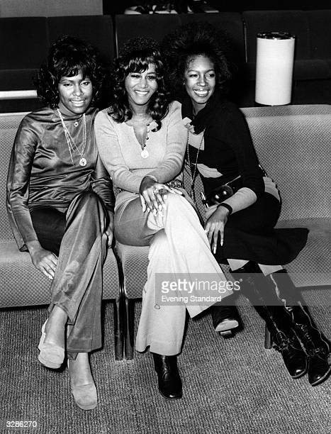Soul pop vocal group the Supremes at Heathrow airport from left to right Jean Terrel Cindy Birdsong and Mary Wilson