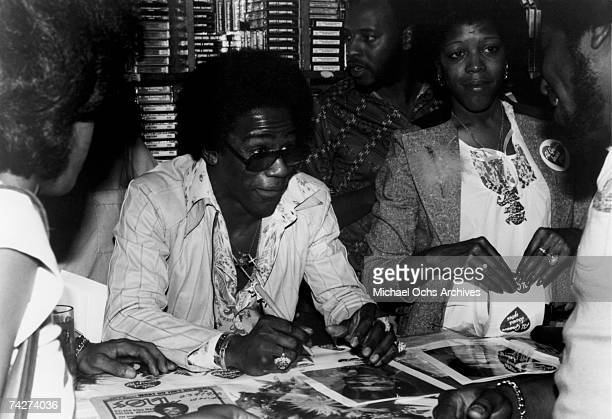 Soul singer Al Green signs autographs at VIP Record Store for fans in circa 1976 in Los Angeles, California.