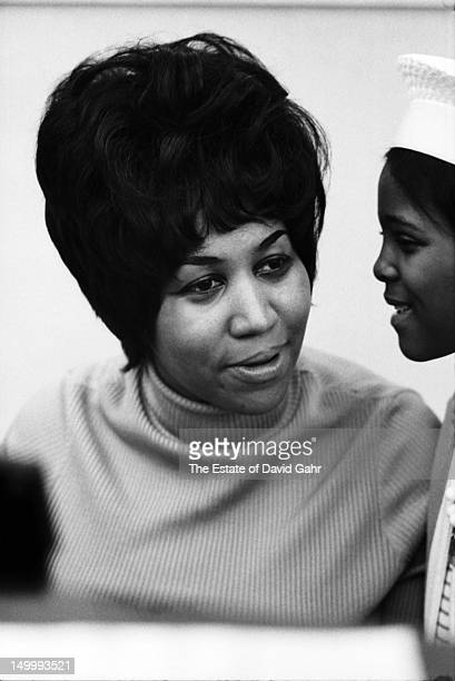 Soul singer Aretha Franklin and a young family member pose for a portrait in the studios of Atlantic Records in April 1968 in New York City New York