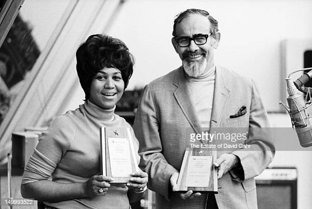 Soul singer Aretha Franklin and producer Jerry Wexler pose for a portrait with an award from 16 Magazine to Ms Franklin in the studios of Atlantic...