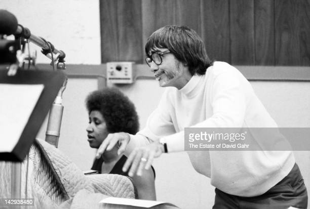 Soul singer Aretha Franklin and producer Tom Dowd at Atlantic Records Studios during a recording session in April 1973 in New York City, New York.