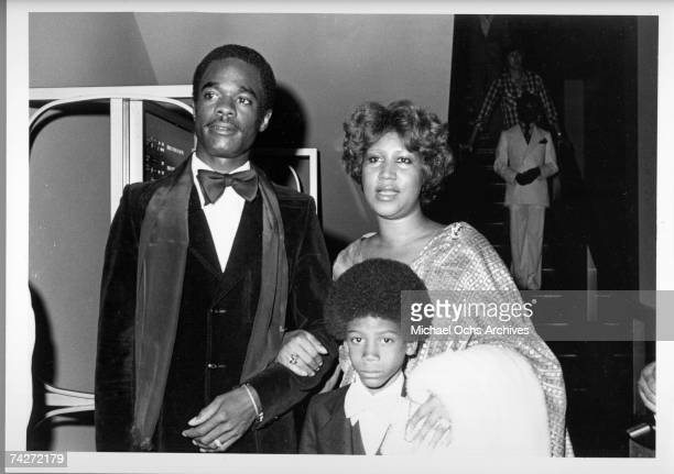 Soul singer Aretha Franklin attends an event with her husband actor Glynn Turman and her son Kecalf Franklin in circa 1979