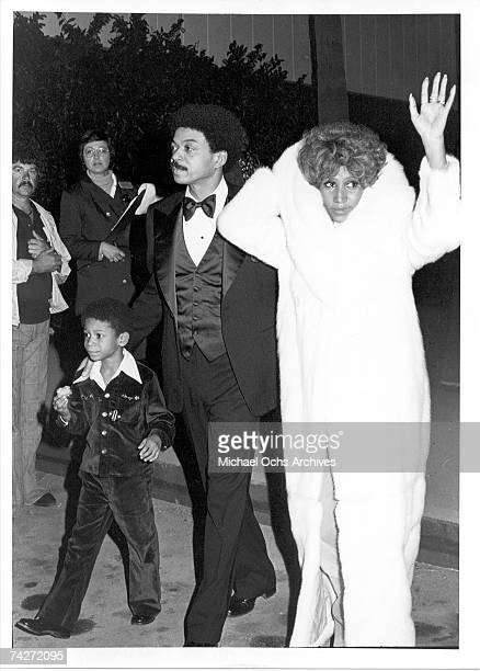Soul singer Aretha Franklin attends an event with her son Kecalf Franklin and a man in circa 1975