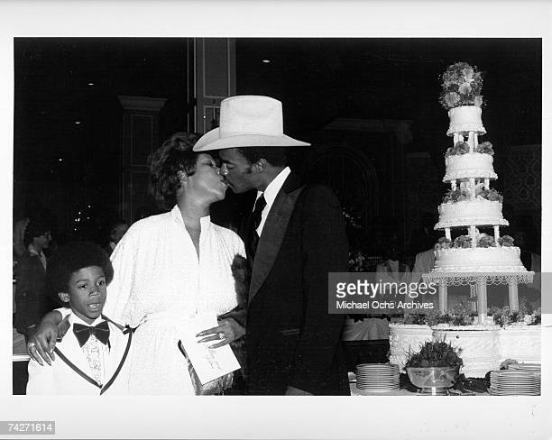 Soul singer Aretha Franklin kisses her new husband actor Glynn Turman as her son Kecalf Franklin looks on at their wedding at her father's New Bethel...