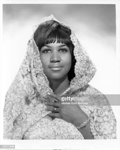 Soul singer Aretha Franklin poses for a portrait wearing a shroud in circa 1967