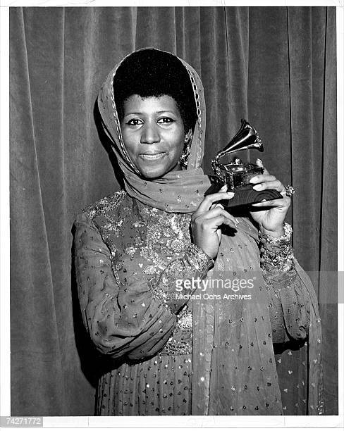 Soul singer Aretha Franklin receives a Grammy for best female rhythm blues performance for the 5th consecutive year this year for her rendition of...
