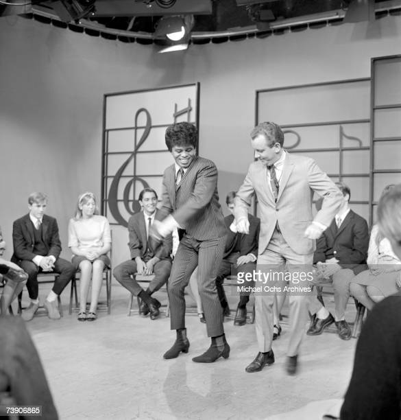 Soul singer James Brown performs at KCOP Studios on the Lloyd Thaxton Show with Lloyd Thaxton in 1964 in Los Angeles California