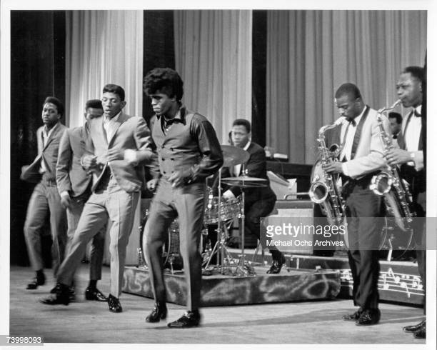 Soul singer James Brown performs onstage with Johnny Terry Bobby Byrd and Bobby Bennett of the Famous Flames at the Apollo Theatre in New York New...