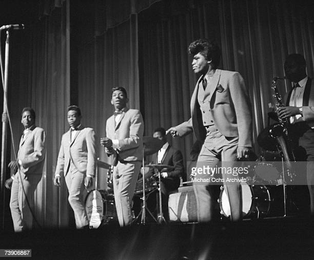 Soul singer James Brown performs onstage with the Famous Flames at the Apollo Theatre in 1964 in New York New York