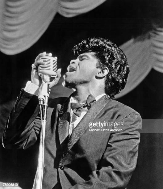 Soul singer James Brown sings in to a vintage microphone as he performs onstage in 1962 in New York New York