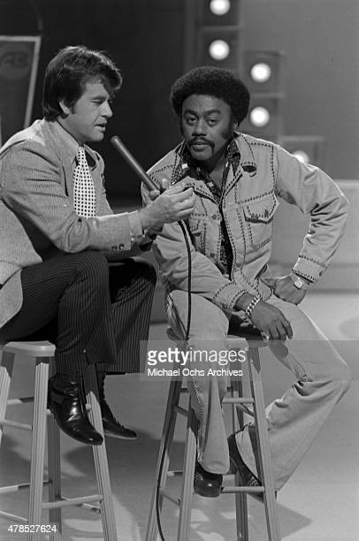 Soul singer Johnnie Taylor performs onstage with host Dick Clark on the TV show American Bandstand on September 29 1973 in Los Angeles CA