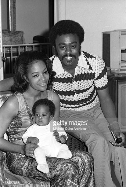 Soul singer Johnnie Taylor poses for a portrait with his wife Gerlean Rockett and their child at the Beverly Hills Hotel on July 10 1972 in Los...