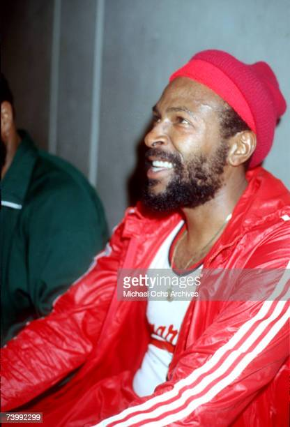 Soul singer Marvin Gaye rests on the bench wearing a red beanie and  basketball uniform during 7de48e4956c