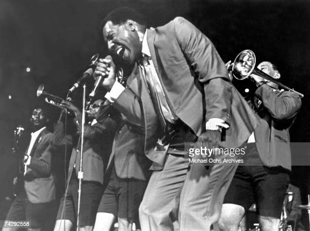 Soul singer Otis Redding passionately sings with his horn section behind him as he performs onstage in 1967