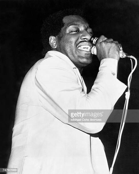 Soul singer Otis Redding performs onstage with a microphone in 1966