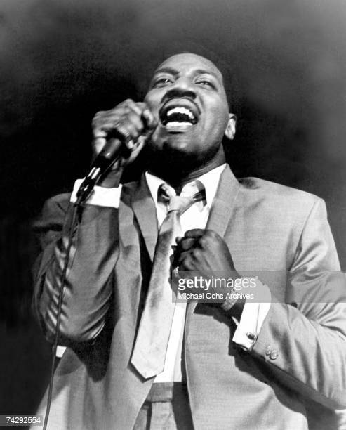 Soul singer Otis Redding sings passionately as he performs onstage in 1967