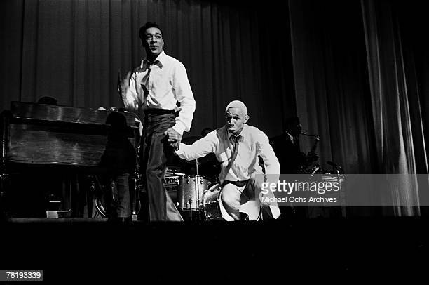 Soul singer Tommy Hunt engages in some tomfoolery with Herlumier Strubbles circa 1964 at the Apollo Theater in Harlem New York