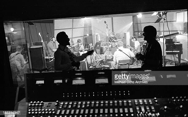 Soul singer Wilson Pickett chats with producer Tom Dowd as the band records at Muscle Shoals Recording Studios on November 24, 1969 in Sheffield,...