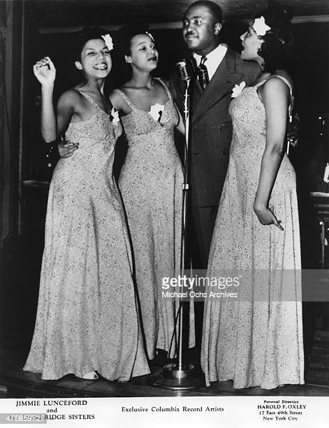 Soul singers Jimmy Lunceford and the Dandridge Sisters including Dorothy Dandridge perform onstage in circa 1940