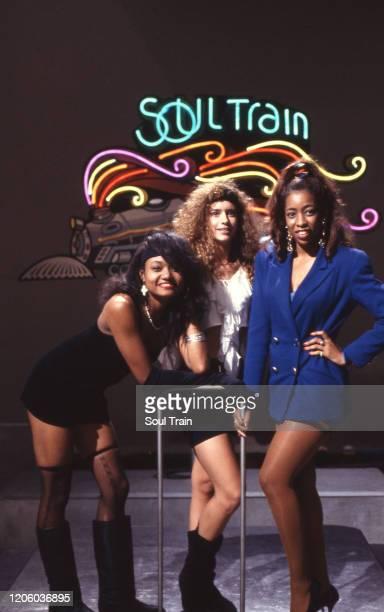Soul Train Dancers Danielle Lopez Heidi Llovet and Juillete Hagerman strike a pose in front of the neon Soul Train sign circa 1991