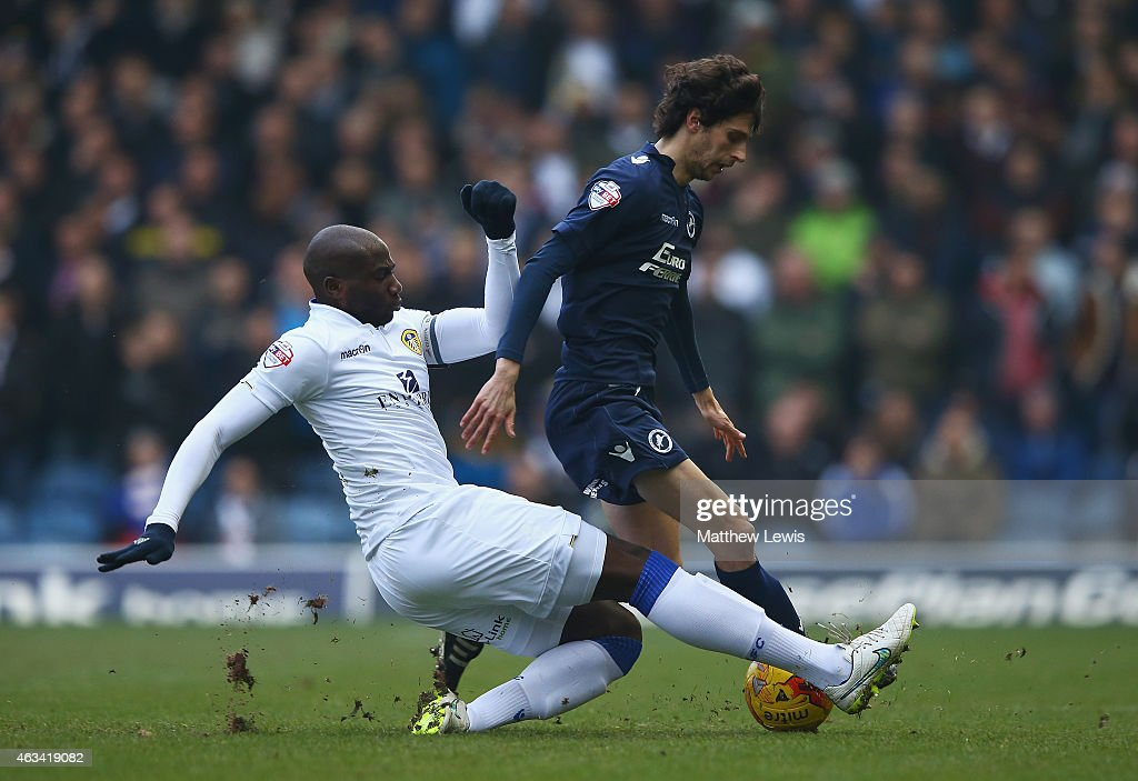 Souleman Bamba of Leeds tackles Diego Fabbrini of Millwall during the Sky Bet Championship match between Leeds United and Millwall at Elland Road on February 14, 2015 in Leeds, England.