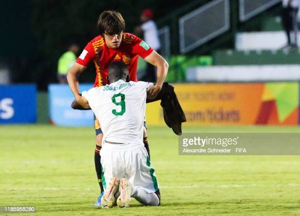 Souleyamme Faye of Senegal is conforted by Pablo Moreno of Spain after the match for the FIFA U17 World Cup Brazil 2019 on November 06 2019 in...