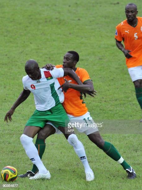 Souleyman Bamba of 'The Elephants' the Ivory Coast's national football team vies with Dagano Moumini of Burkina Faso on September 5 2009 in Abidjan...