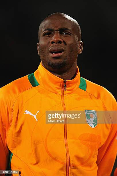 Souleymane Bamba of Ivory Coast lines up for the National Anthem ahead of the FIFA 2014 World Cup Qualifier Playoff Second Leg between Senegal and...